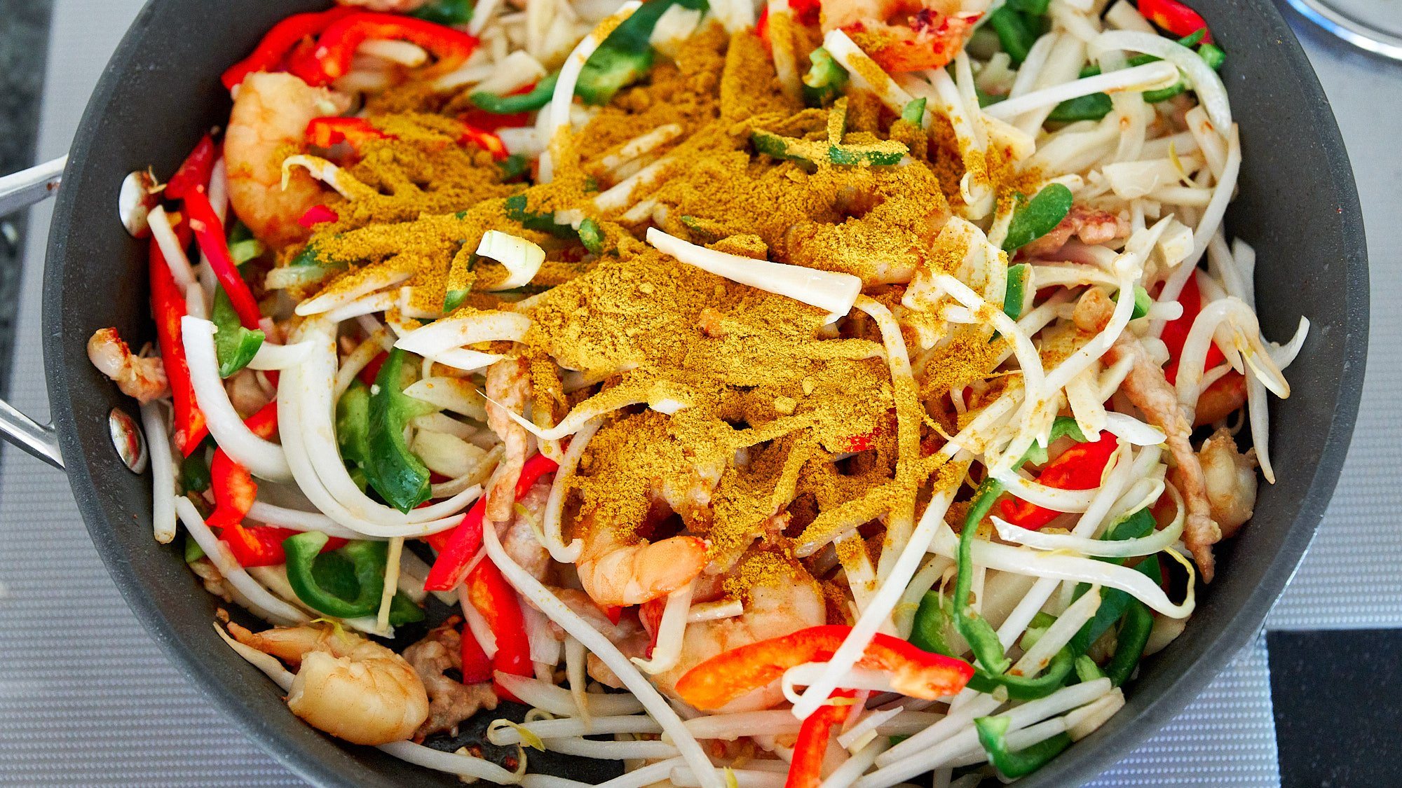 Curry powder is what gives Singapore noodles their yellow color and spicy taste.