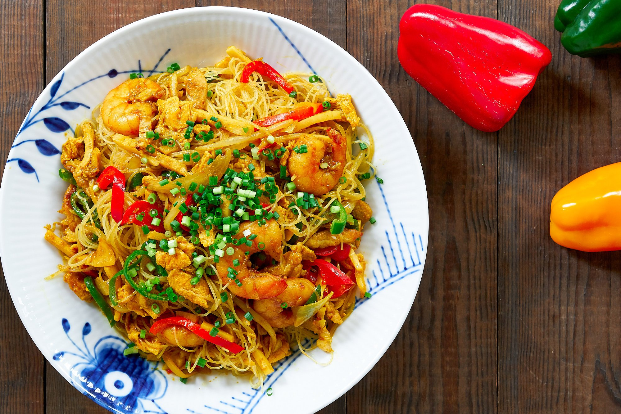 Singapore Noodles are a delicious Chinese-American one-pan meal loaded with shrimp, veggies, and curry flavored rice noodles.