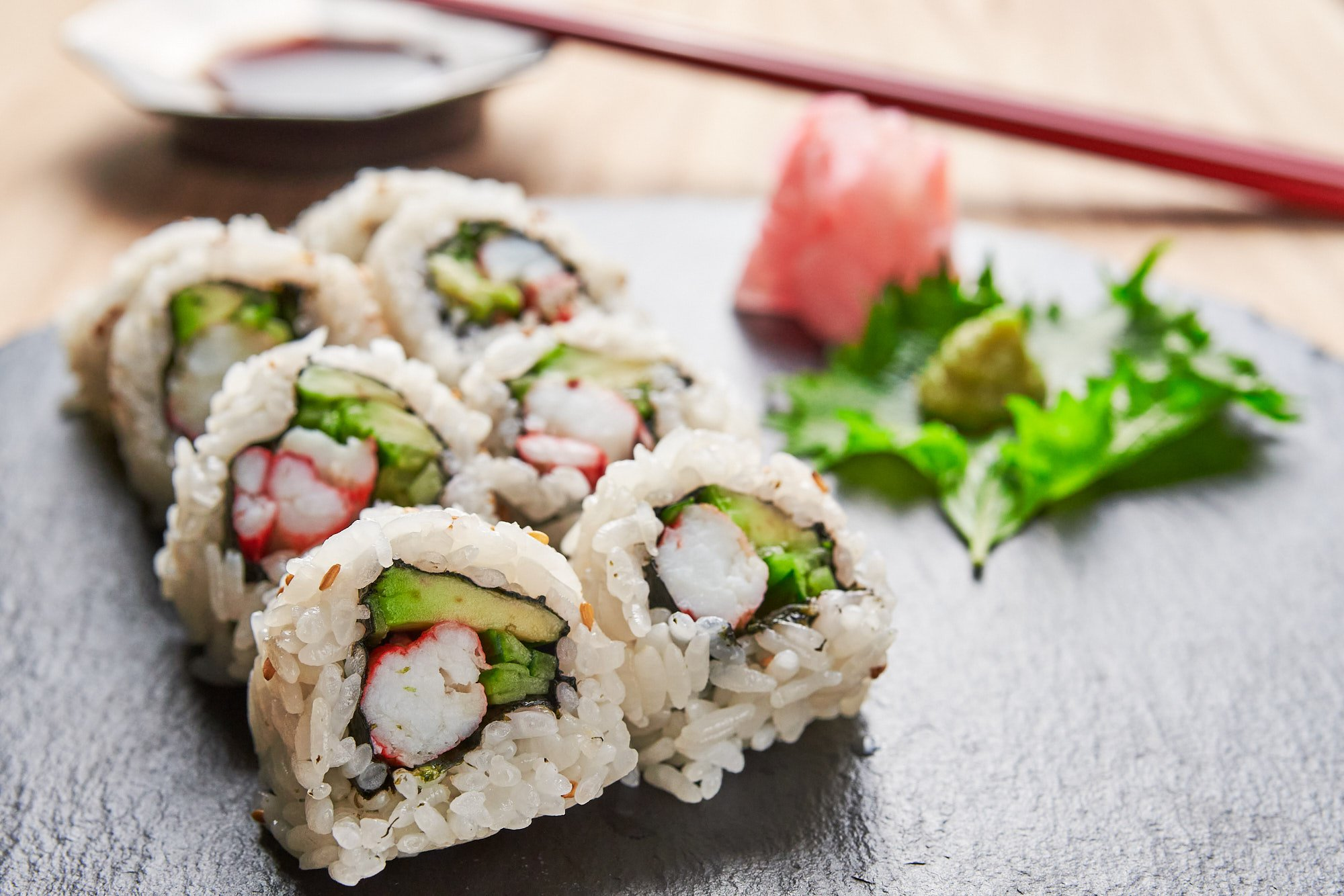California rolls stuffed with avocado, king crab, and cucumber.