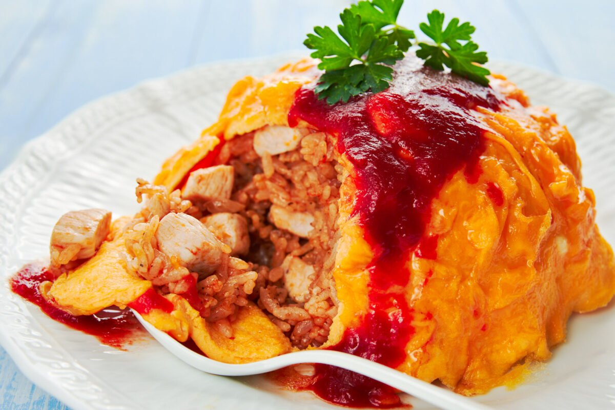 Omurice is a mashup of savory sweet chicken fried rice with a creamy omelette.