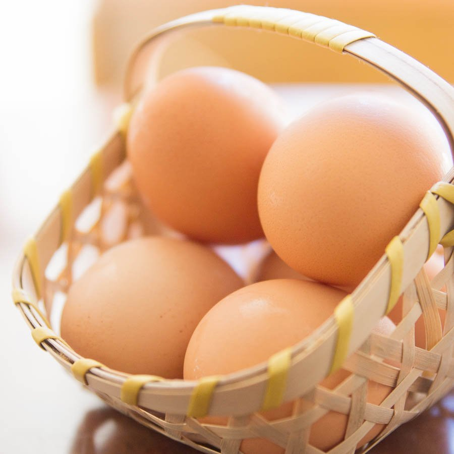 A basket of farm-fresh eggs are perfect for making boiled eggs when you know the right techniques.