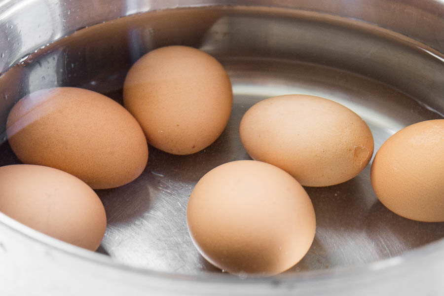 Brown eggs in a pot large large enough to hold double the amount of eggs, covered with an inch of water.