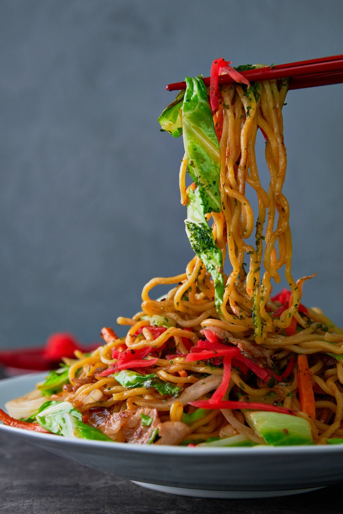 Long Chinese-style noodles stir-fried with cabbage, carrots and onions.