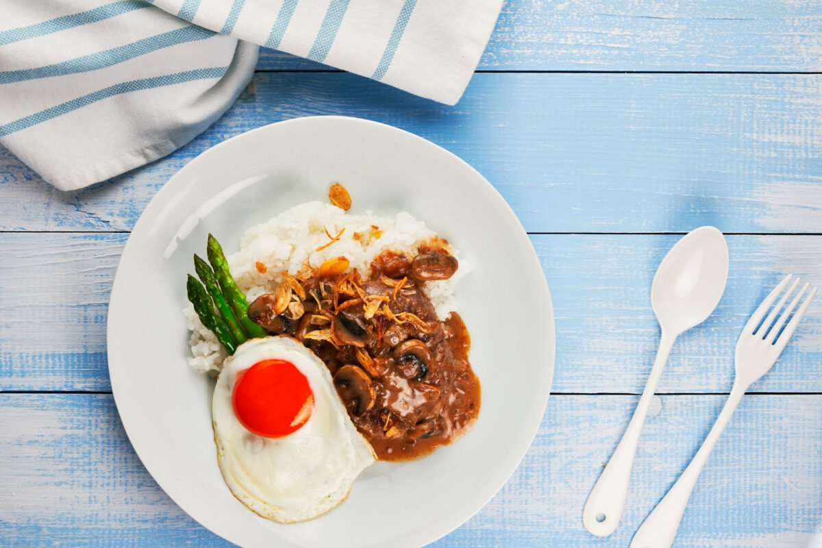 Plate of Hawaiian Hamburger (Loco Moco) with a fried egg, and mushroom gravy on rice.