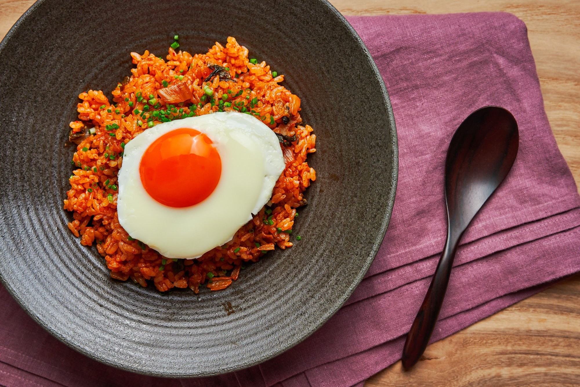 Spicy and loaded with flavor, Kimchi Fried Rice is an easy meal that comes together from just a handful of ingredients.