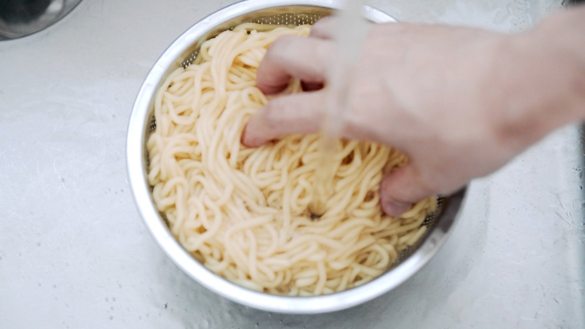 Rinsing Chow Mein noodles.