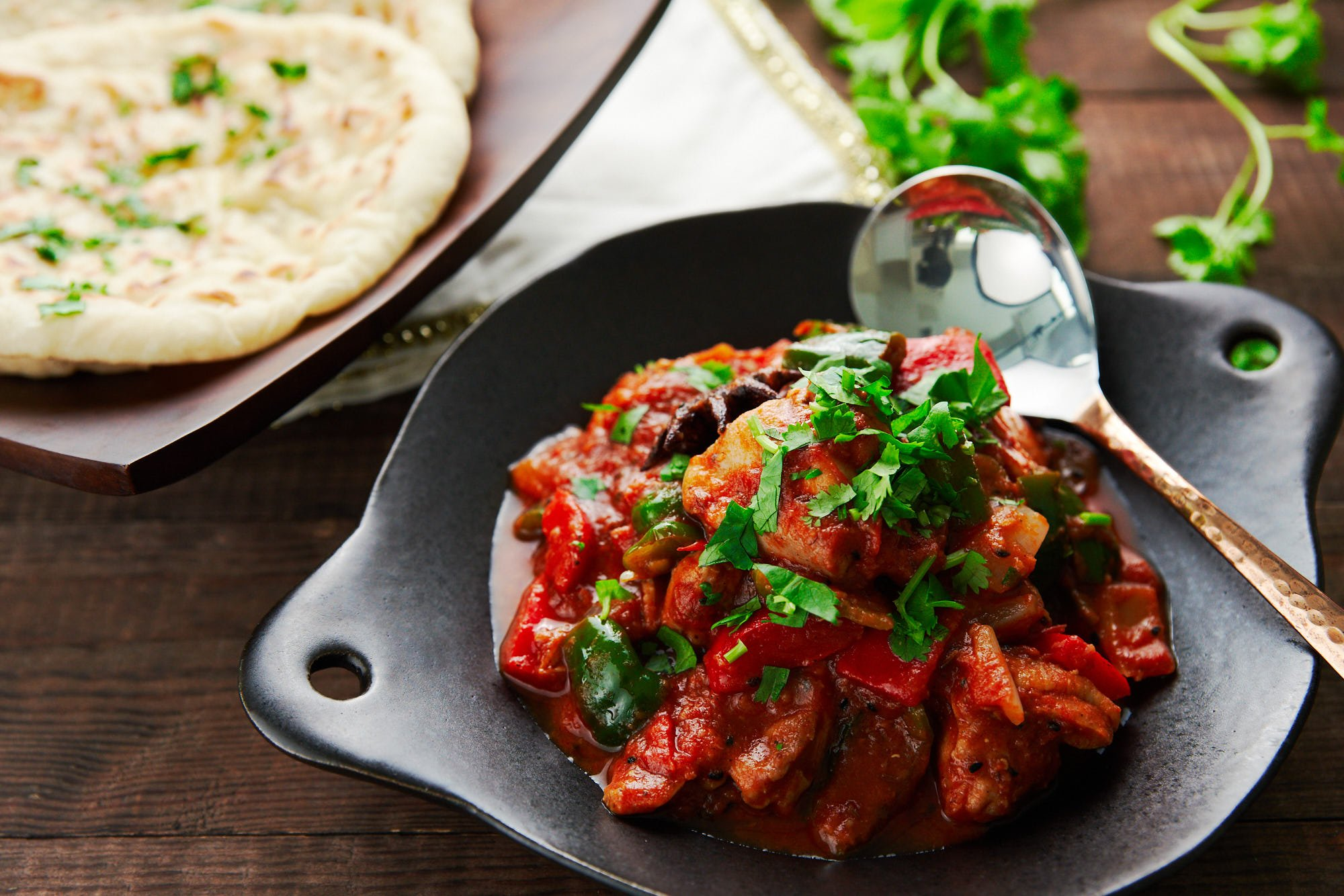 Easy Chicken Jalfrezi recipe with buttered naan.