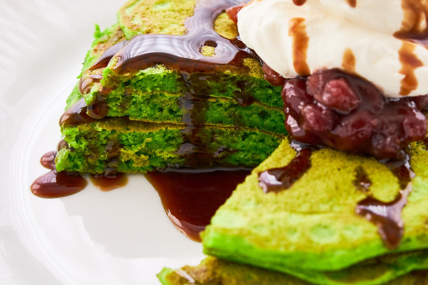 These matcha pancakes are light and fluffy and taste amazing drizzled with kuromitsu syrup.