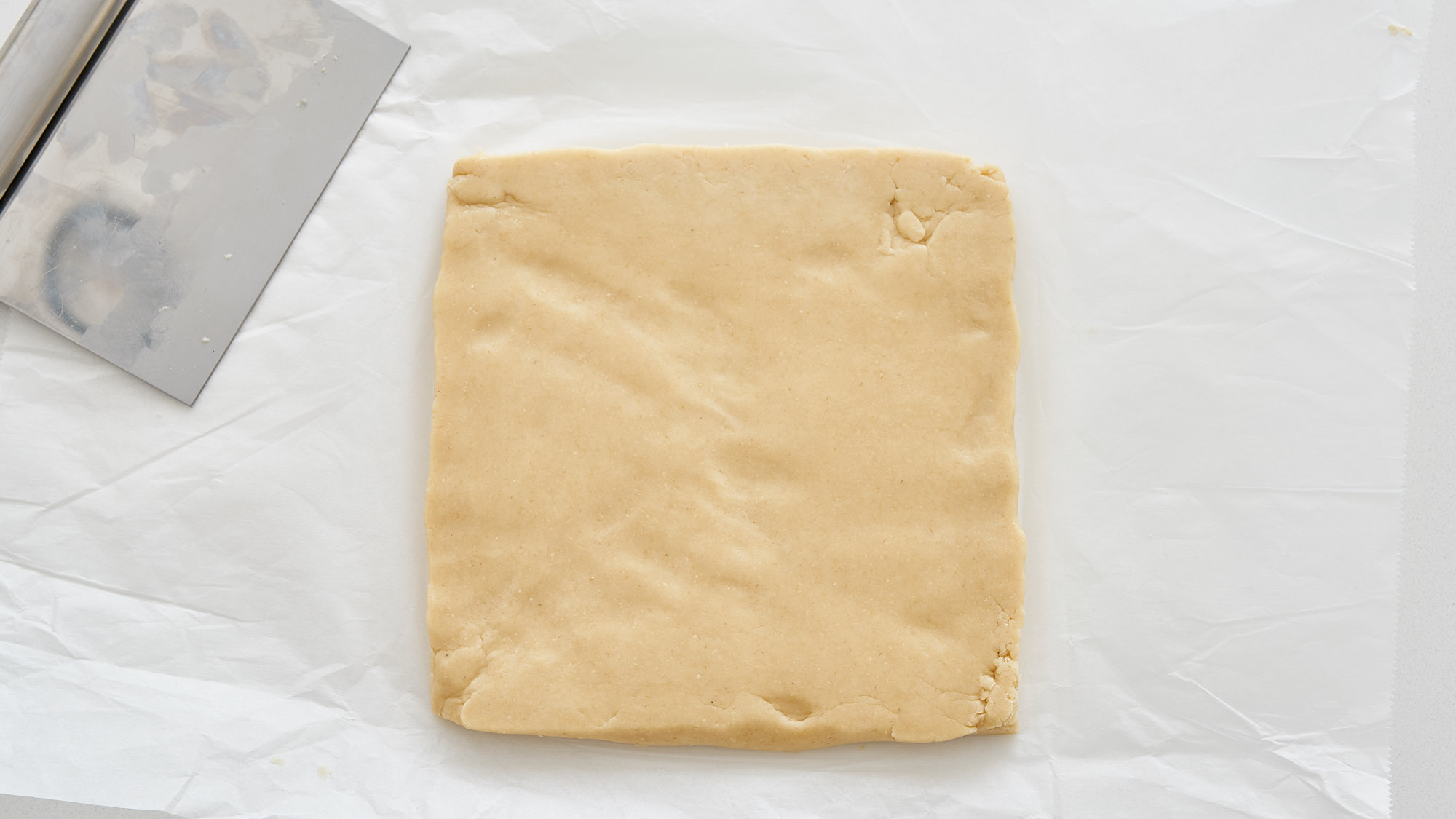 A square of shortbread cookie dough