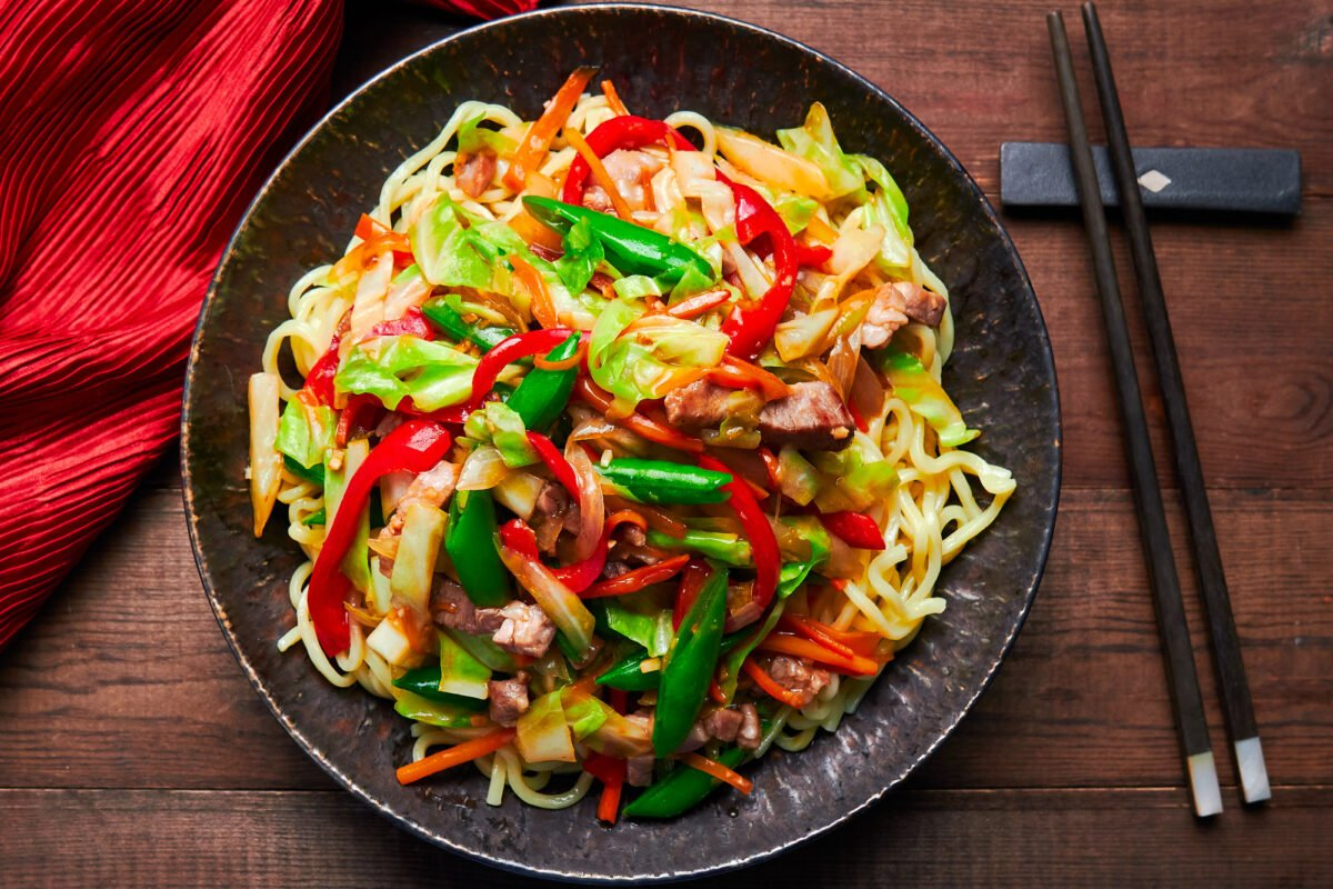 Loaded with veggies and meat and served on a bed of noodles, Chop Suey is a one-dish meal that's easy to make and delicious.