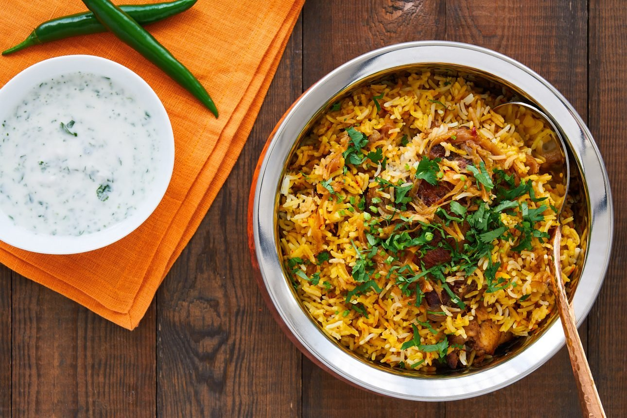 This Chicken Biryani isn't hard to make and yet it's decadently flavorful with spiced chicken and caramelized onions cooked in saffron rice.