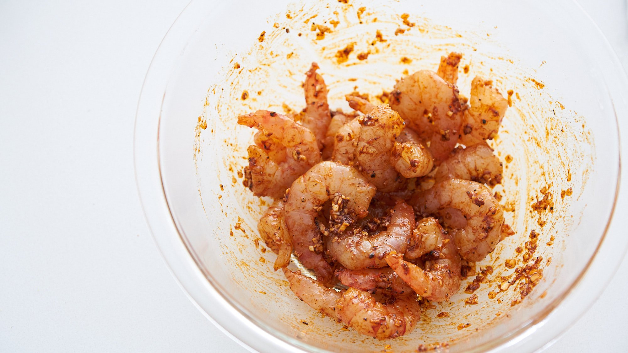 Marinate your shrimp with garlic and paprika for the best shrimp and grits.