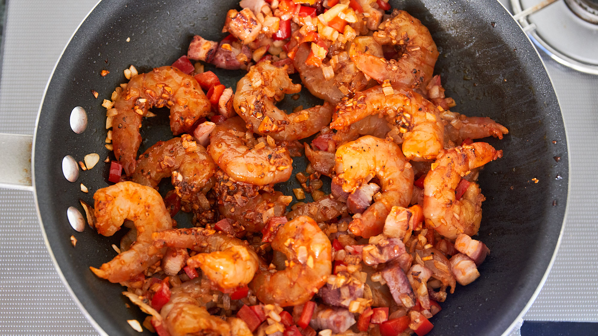Finally add the shrimp and stir-fry until they're just cooked through.