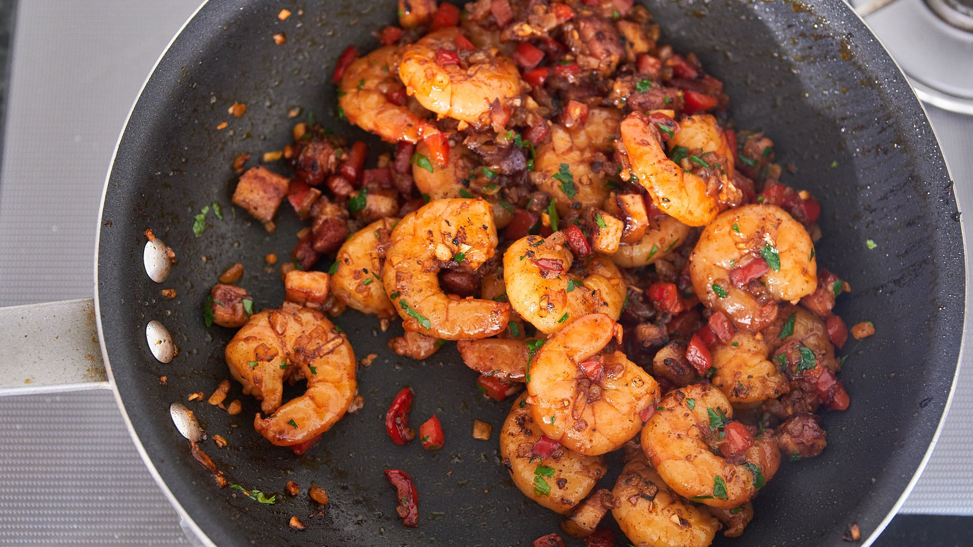 Finish the shrimp with a splash of lemon juice and sprinkle of parsley.