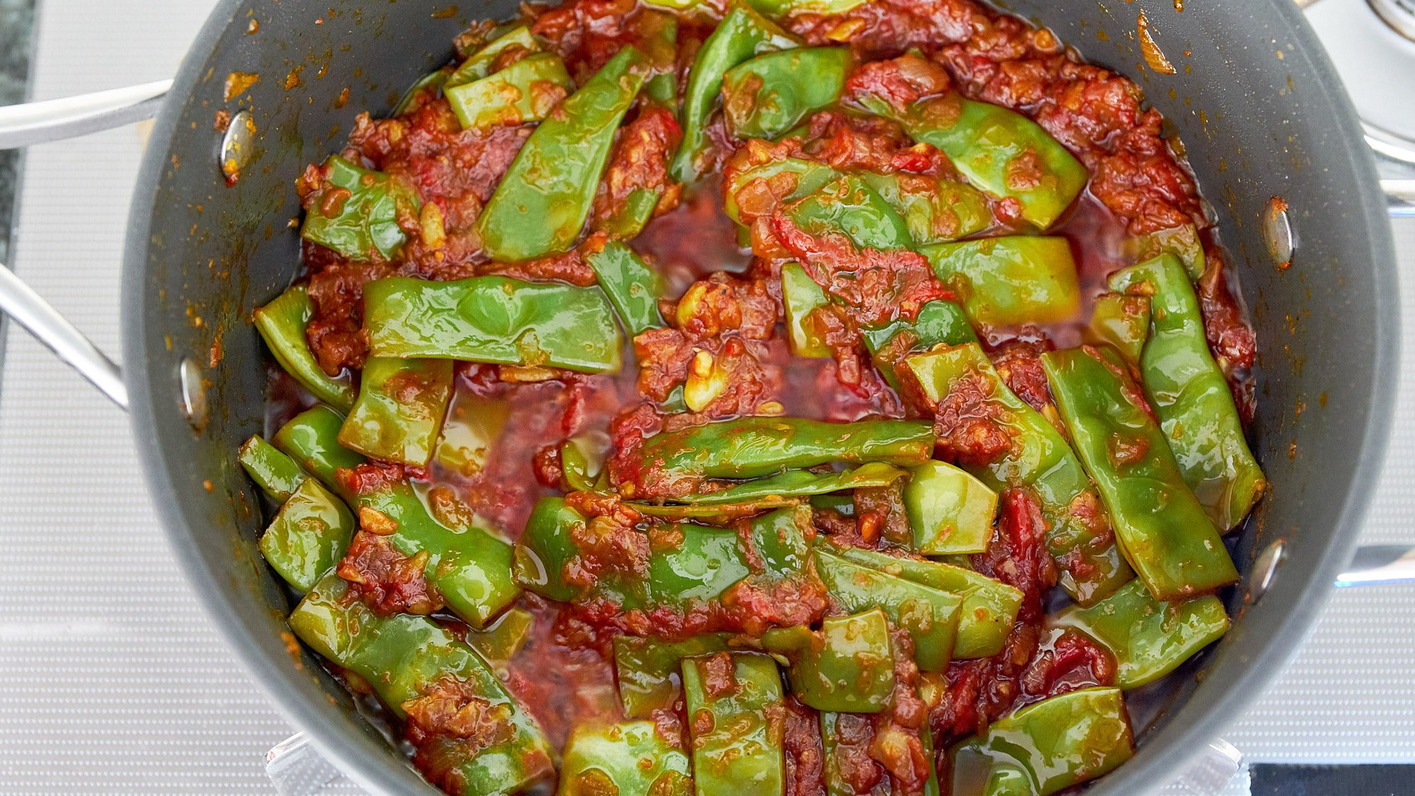 Your Loubieh Bi Zeit is done when the green beans are tender.