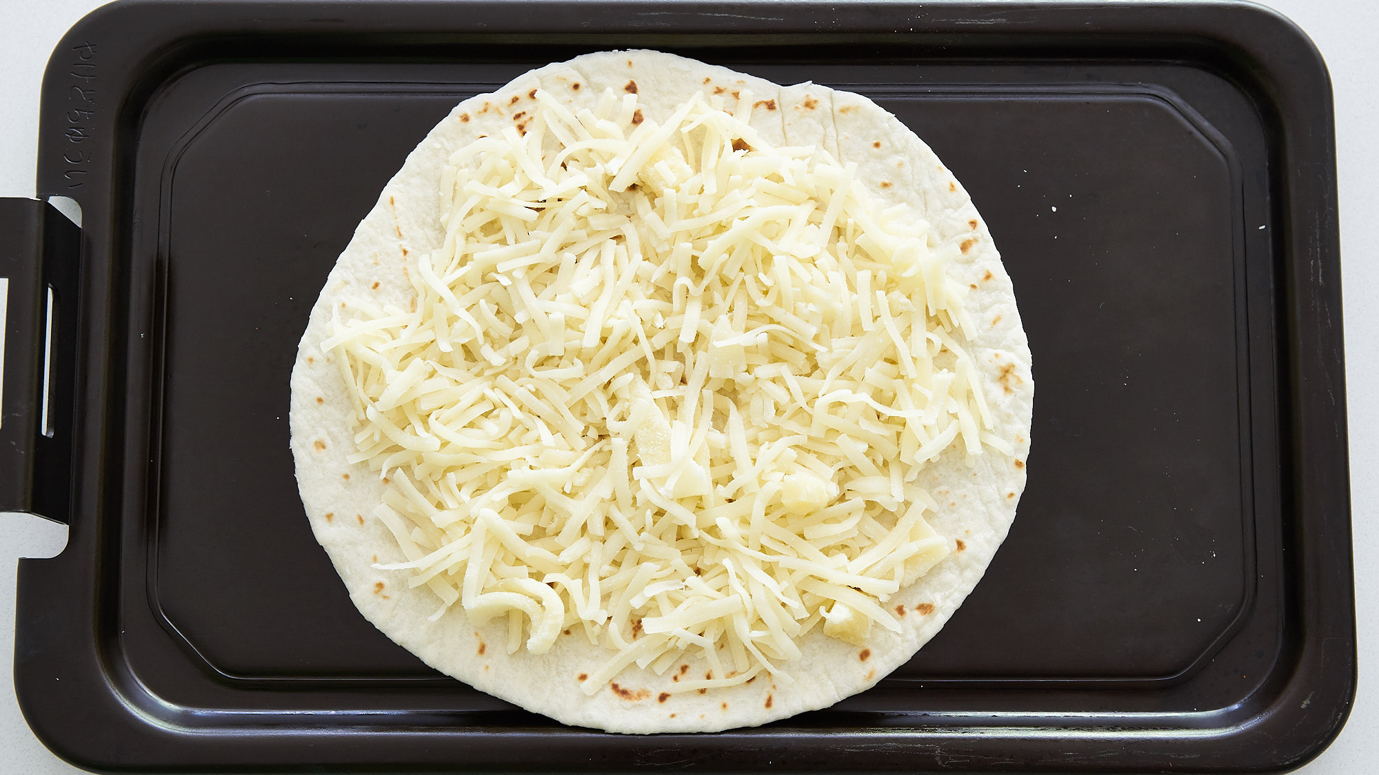 Pizzadilla's start out like a quesadilla with cheese on a tortilla.