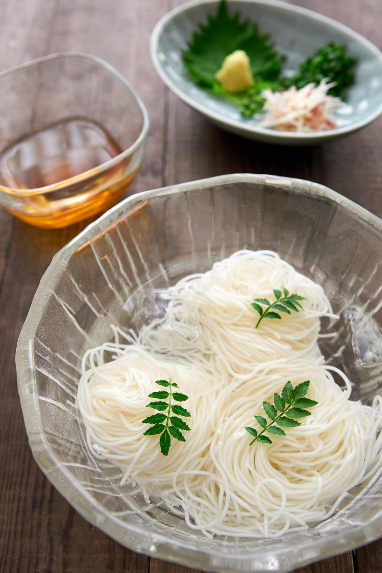 Nothing says summer in Japan like Somen noodles floating in a bowl of ice water. Easy and quick, this summer dish and dipping sauce comes together in less than 5 minutes.