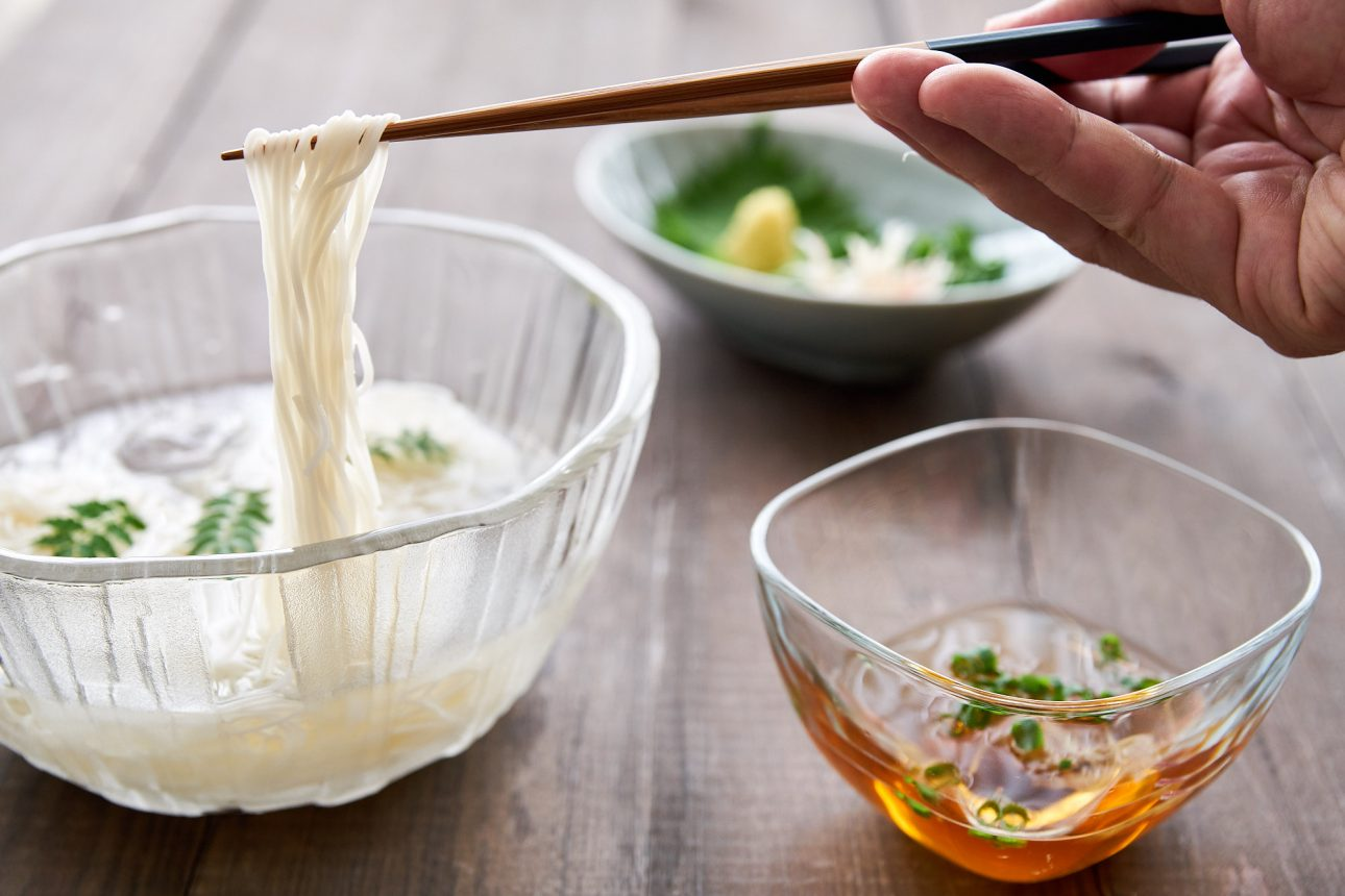 Dip the somen noodles in a light dashi broth loaded with condiments such as ginger, shiso, and scallions.