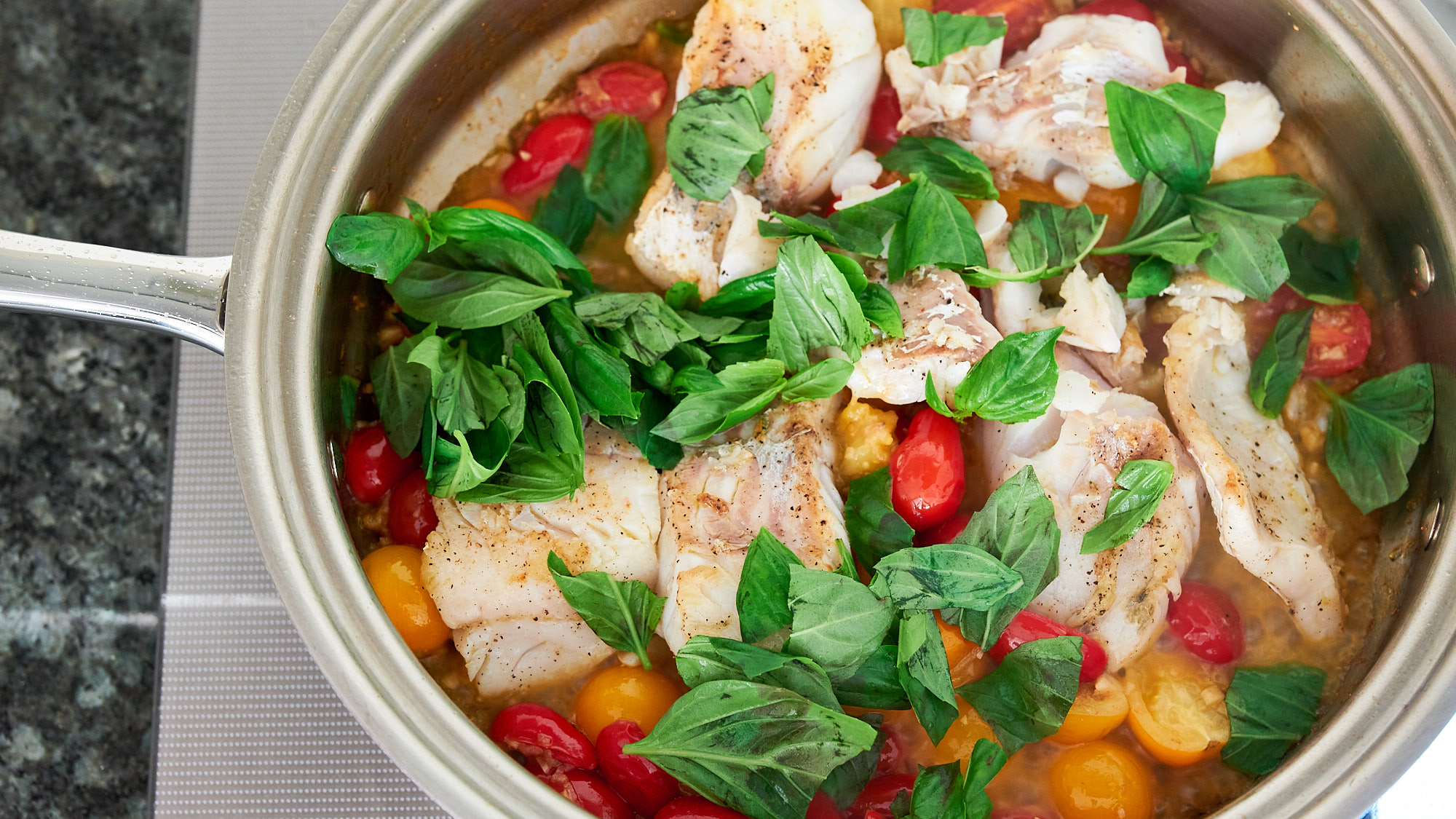 Add the pan-roasted cod back into the pan along with the basil.