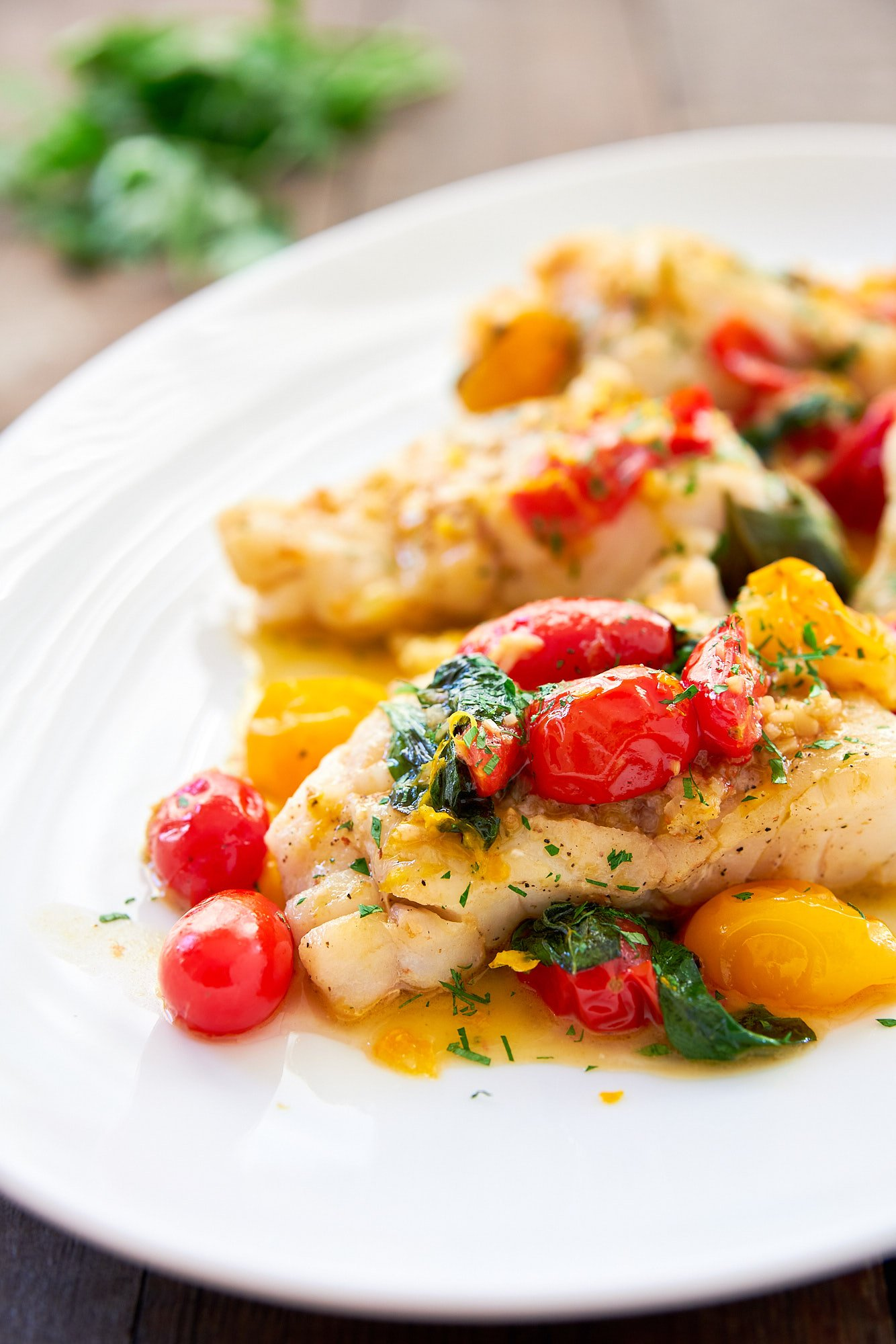 This pan-roasted cod is super easy and delicious! The trick is to make a flavorful pan sauce with cherry tomatoes, basil and white wine.