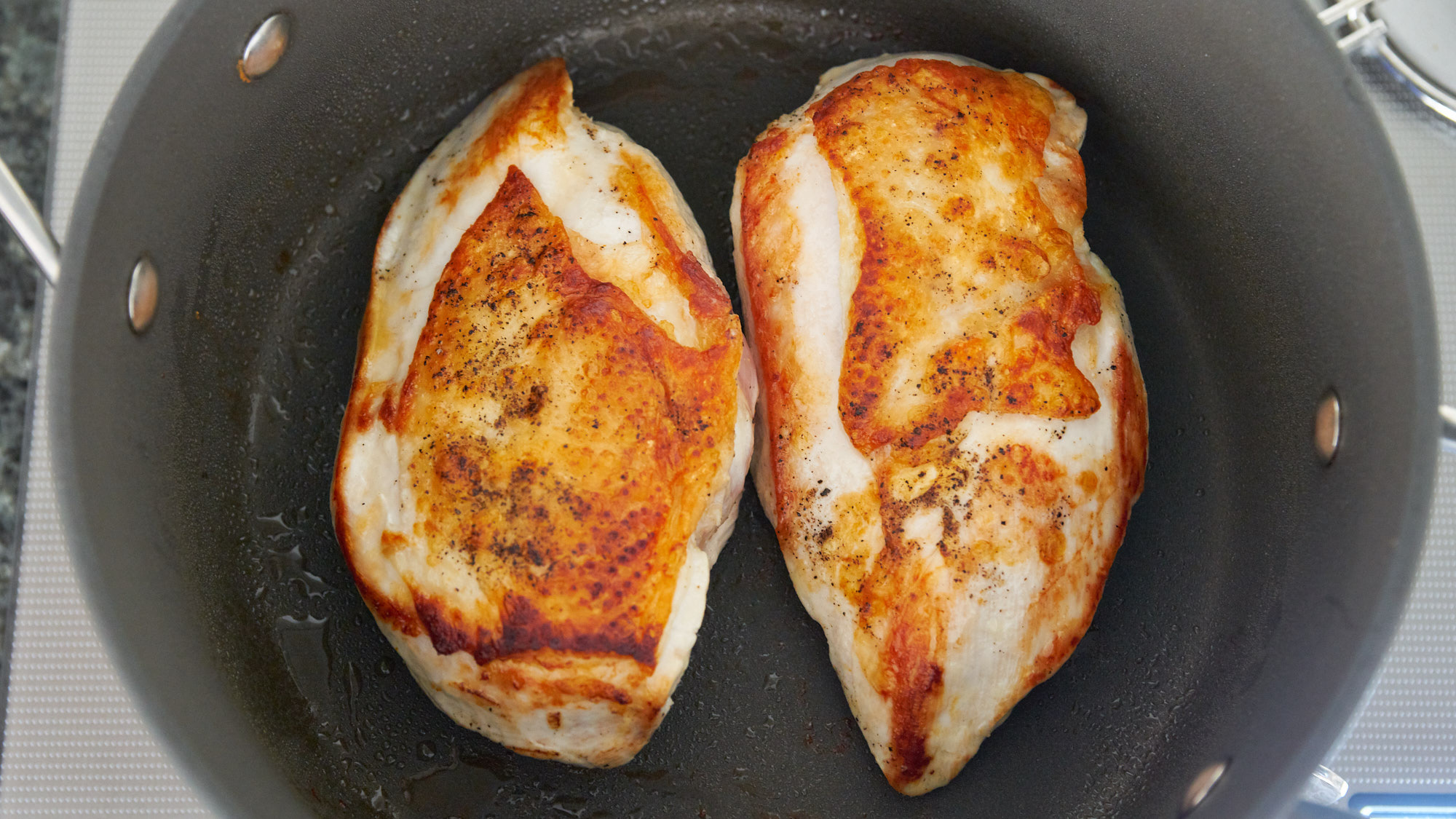 Browm the chicken breasts on both sides for the chicken chili.