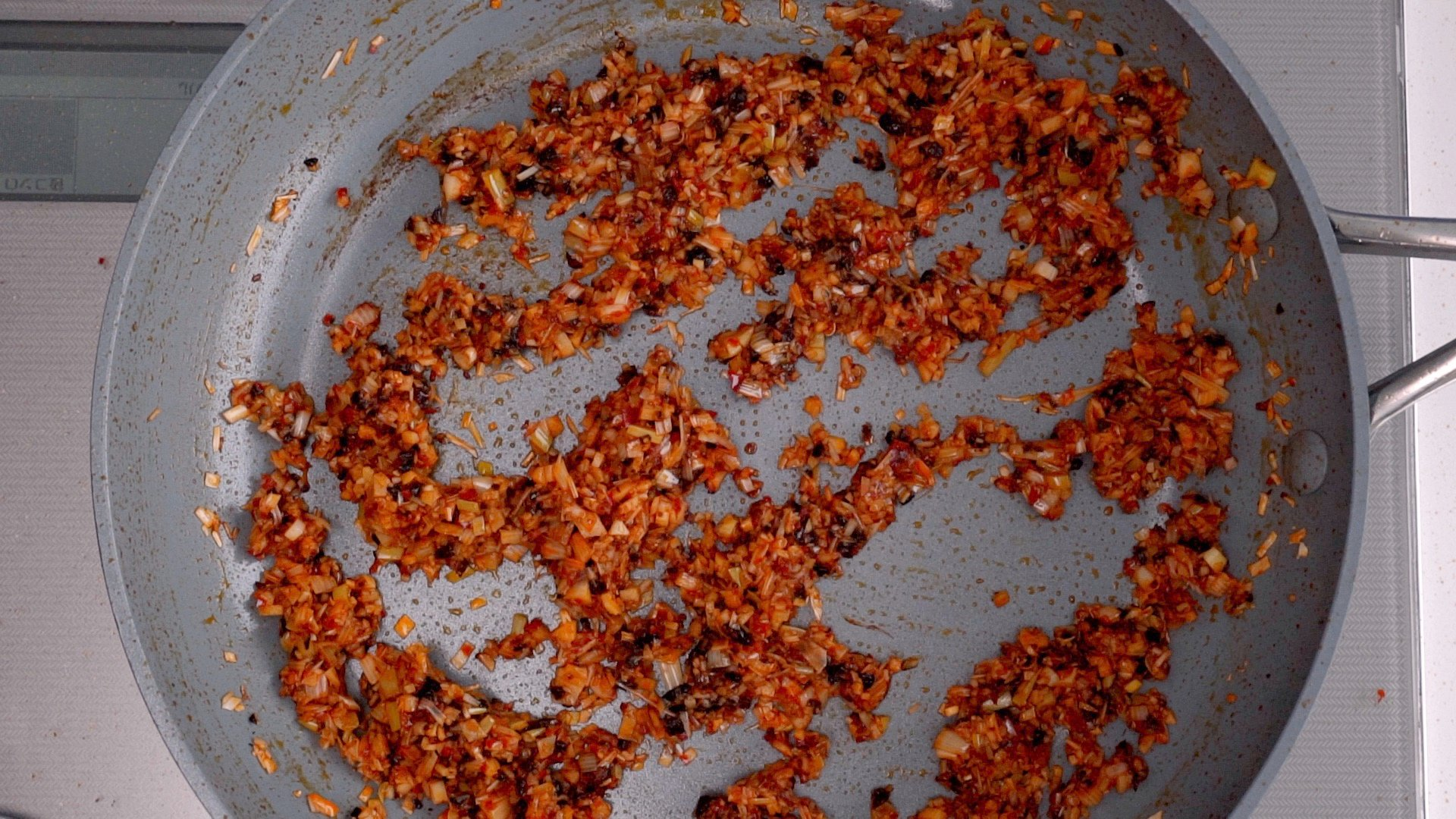 Add the aromatics and stir-fry until they are caramelized.