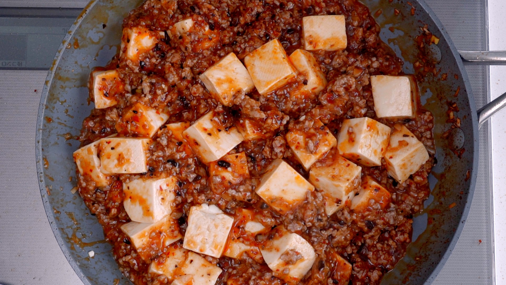 Add the Tofu and simmer together with the sauce.