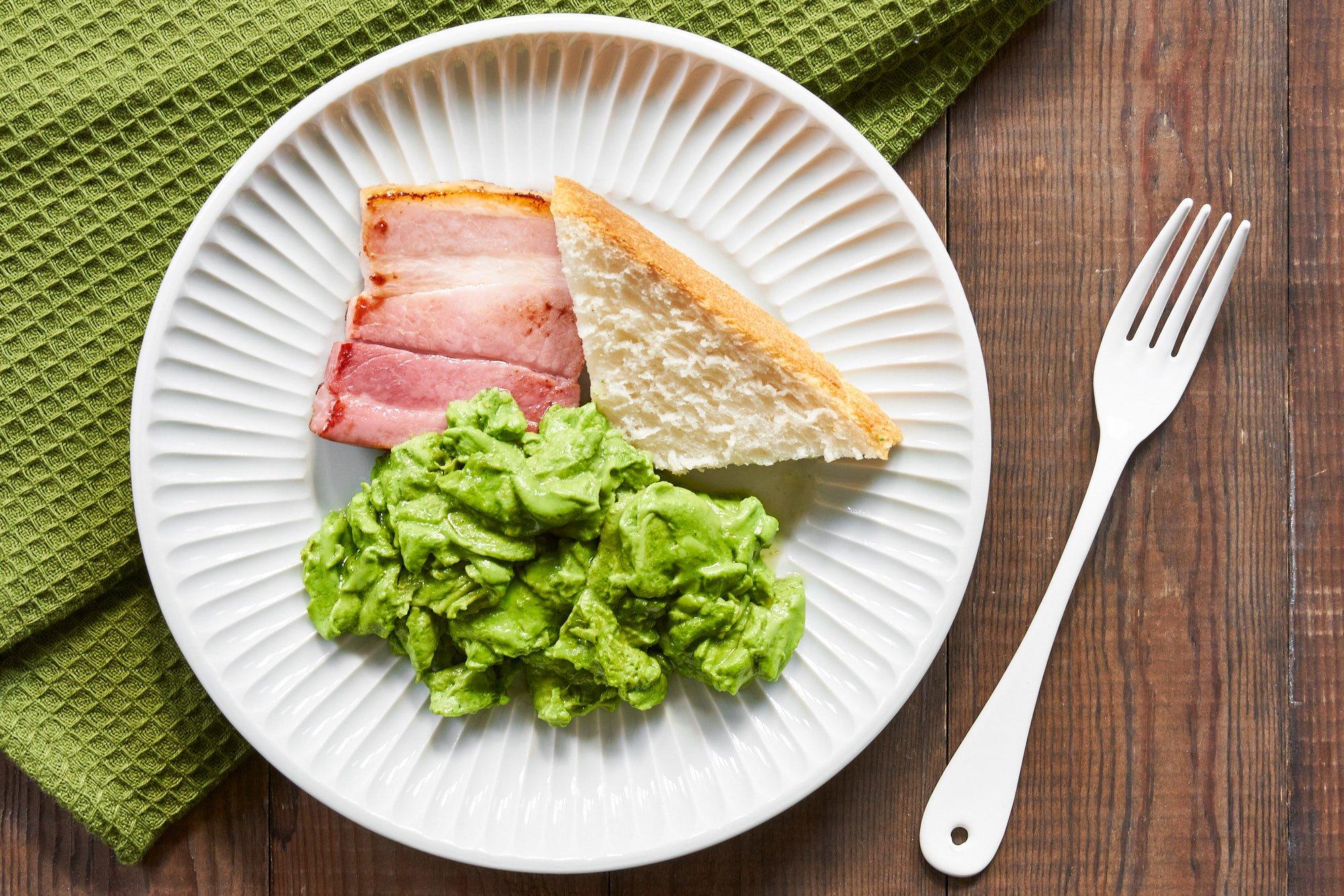 Scrambled green egg whites and ham uses matcha powder to turn the eggs green.