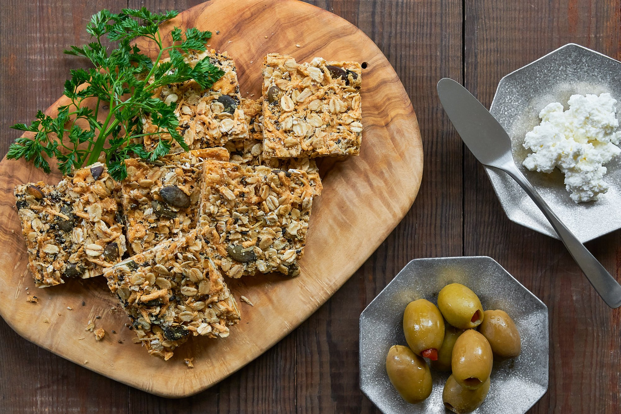 With loads of cheddar and parmesan holding together the oats, chia seeds, pumpkin seeds, and sesame seeds these crisp granola crackers are healthy and delicious.