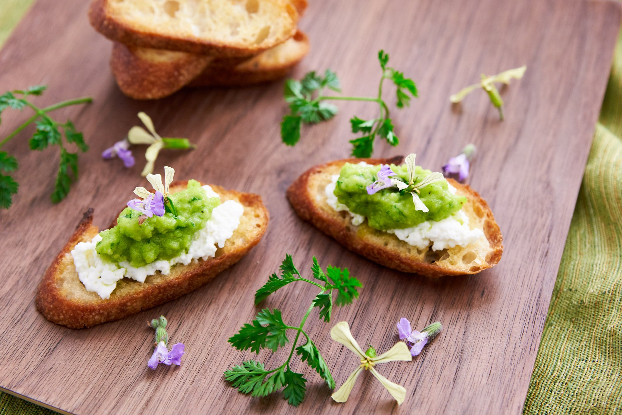Perfect spring green pea pesto with ricotta spread on crostini.