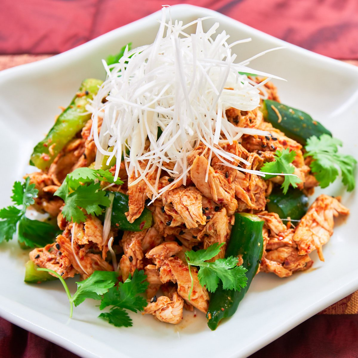 This spicy chicken salad is loaded with juicy shredded chicken and crunchy cucumbers dressed with a sesame chili sauce. Get the details in this Bang Bang Chicken recipe.