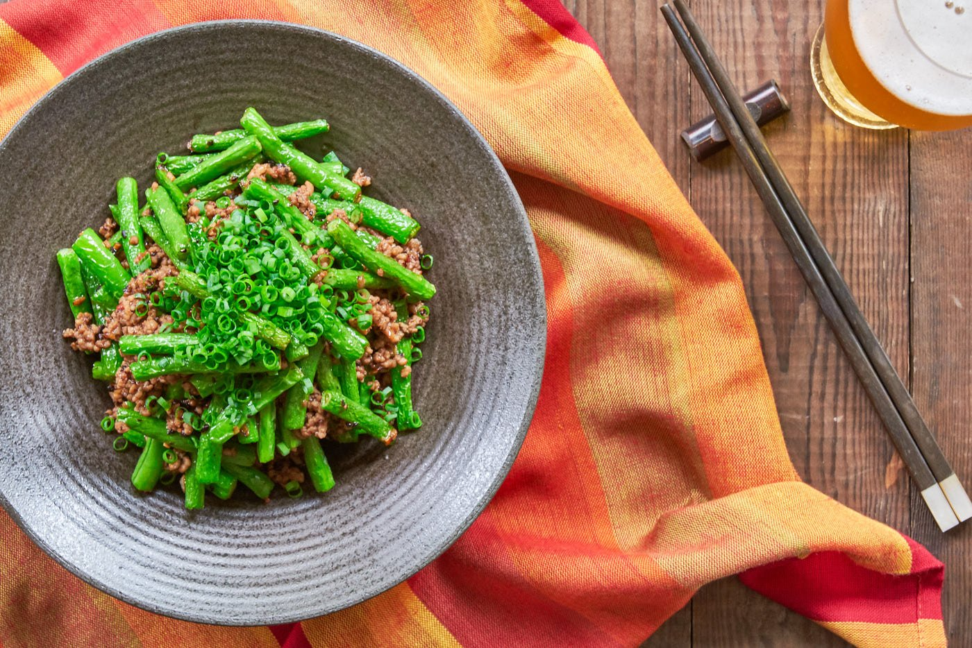 With tender vivid green green beans stir-fried with pork and a chili garlic black bean sauce, this easy delicious stir-fry comes together in just minutes.