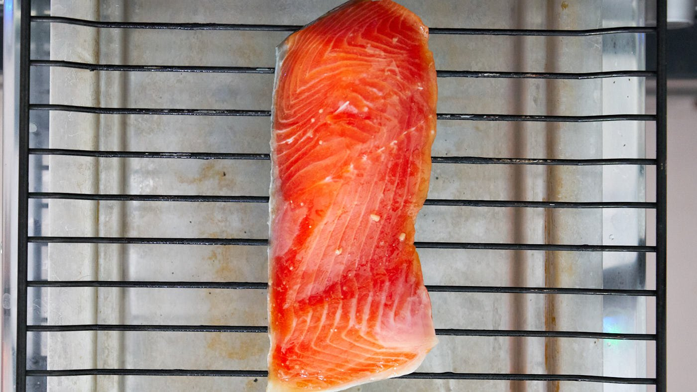 Japanese Miso Salmon on a broiler rack ready to cook.