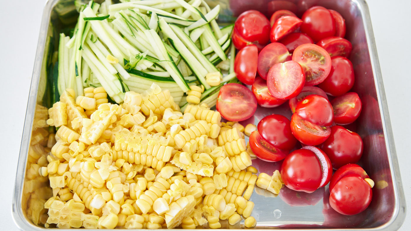 Fresh corn kernals, julienned zucchini, and cherry tomatoes for Pasta Estate (Summer Pasta).