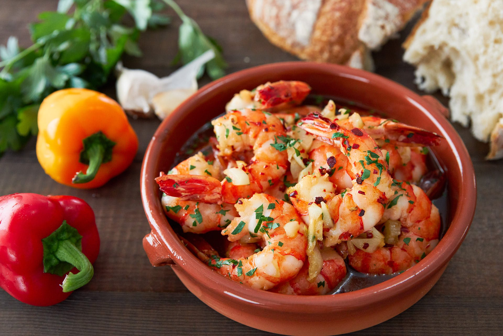Savory and delicious, Spanish Garlic Shrimp (Gambas al Ajillo) is an easy appetizer that comes together in minutes. Crusty bread is a must, to dip in the irresistable garlic shrimp oil.