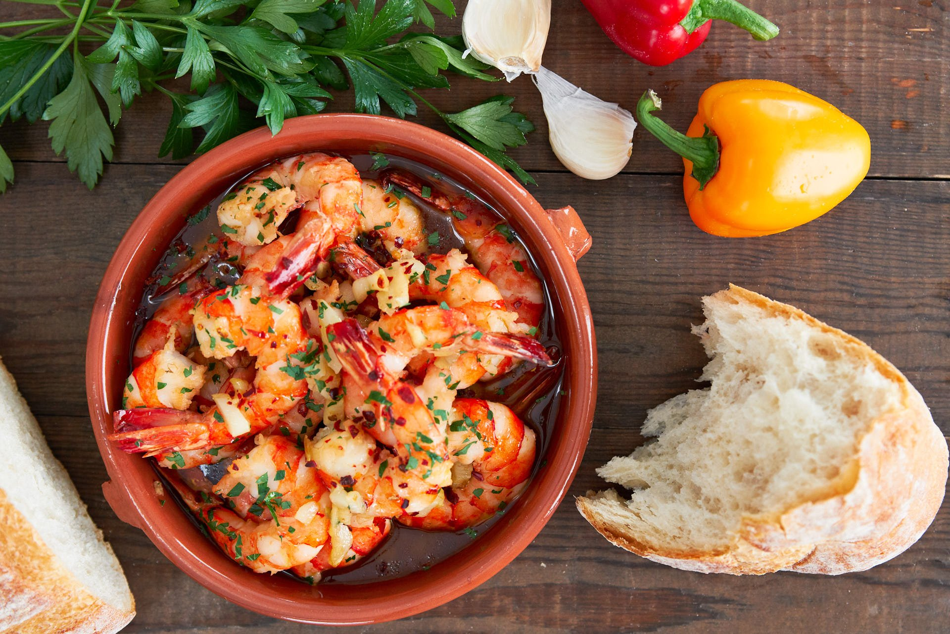 Gambas al Ajillo, or garlic shrimp in a Cazuela de Barro is an easy and delicious Spanish Tapa that comes together in minutes from a handful of ingredients.