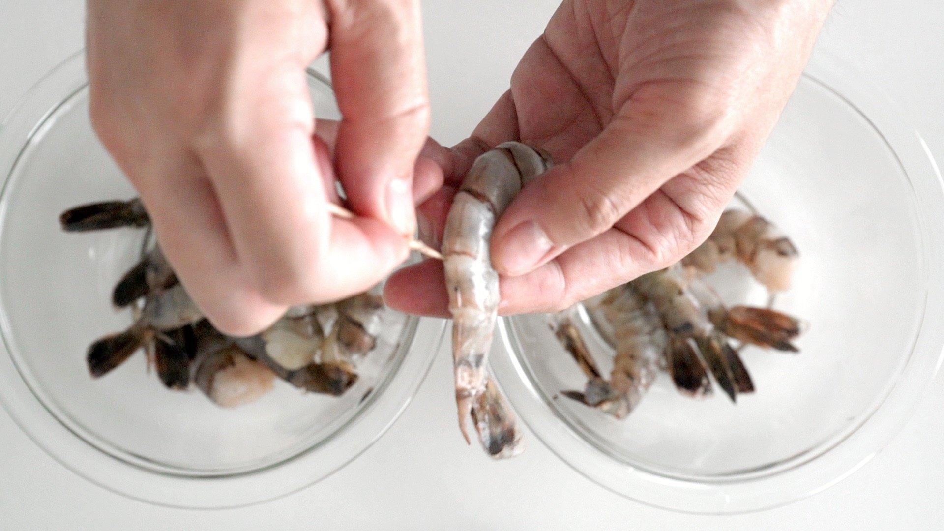Deveining shrimp for gambas al ajillo with a toothpick