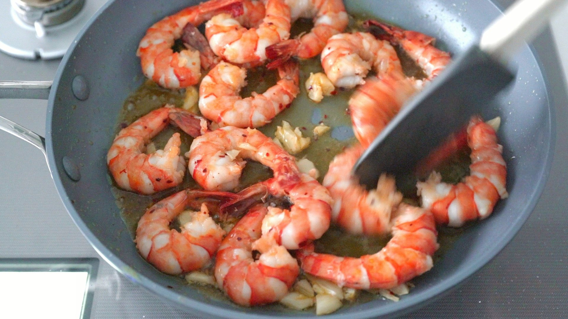 Gambas al Ajillo in a frying pan.