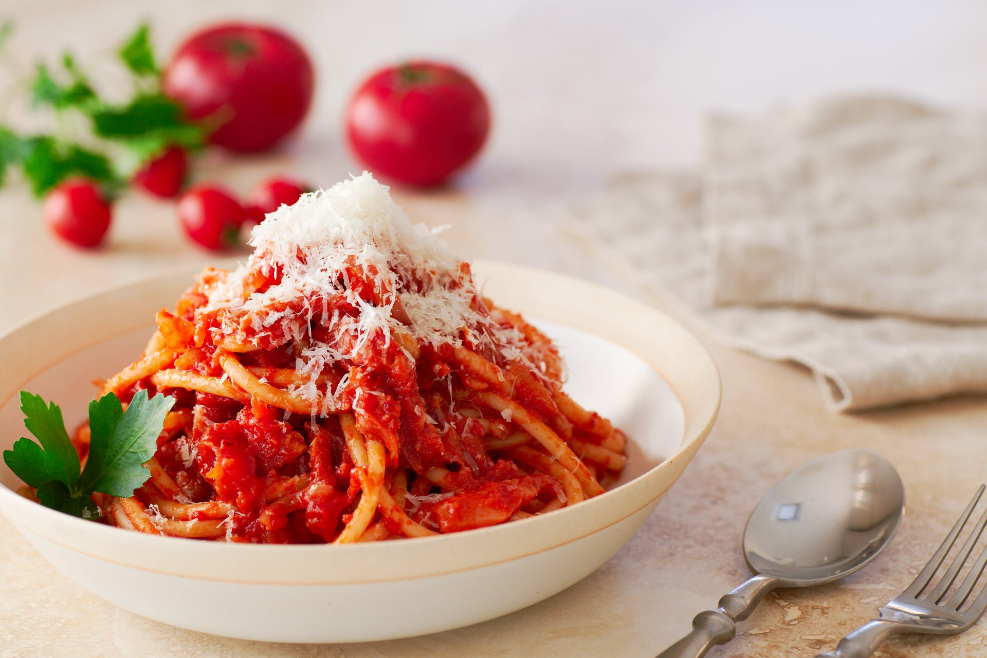 Loaded with Guanciale and Pecorino Romano, Bucatini all'Amatriciana is a quick weeknight pasta that has an unbeatable taste to effort ratio.