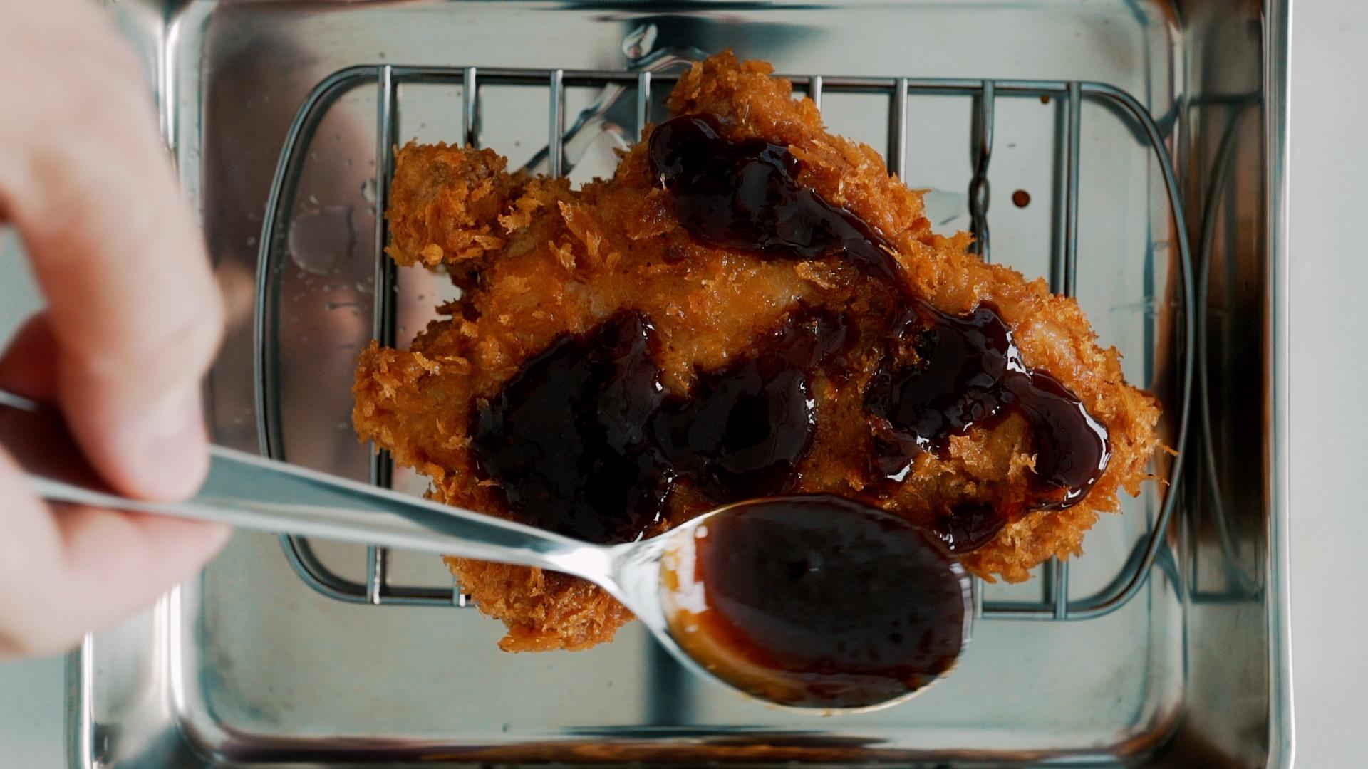 Glazing Tonkatsu with sauce for Katsu Sando