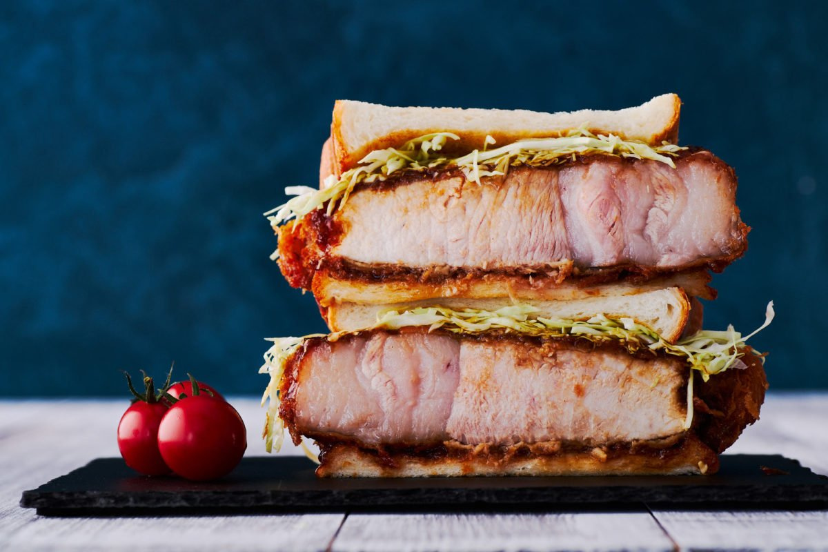 With thick juicy Tonkatsu doused in a sweet, spicy, savory and tangy sauce, this Katsu Sandwich recipe can be made at home with just a handful of ingredients.