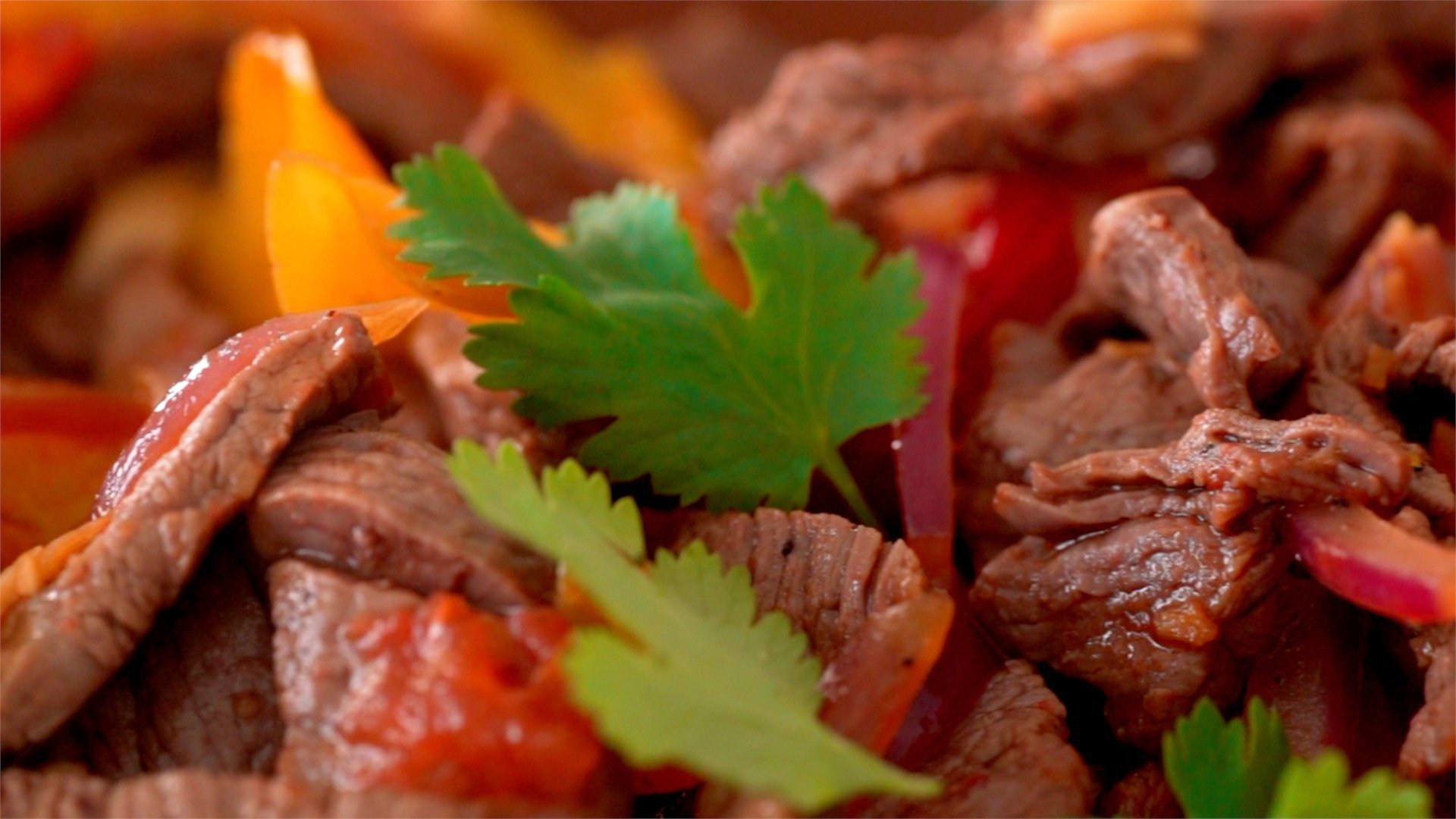 Lomo Saltado is a stir-fry of beef, peppers, tomatoes and onions.