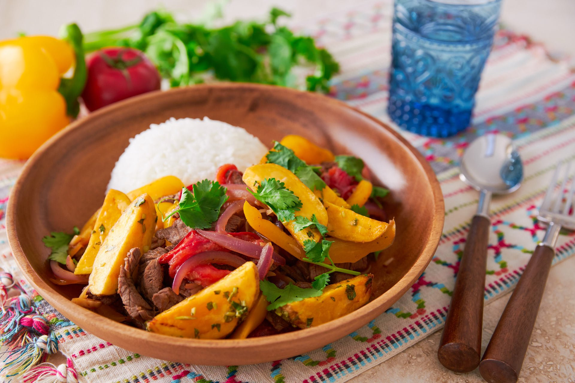 "Lomo Saltado, or ""jumped loin"" is a delicious mashup of Peruvian and Chinese cuisines, featuring beef marinated with soy sauce and pisco stir-fried with onions, tomatoes, and peppers; and it's topped off with crisp French fries!"