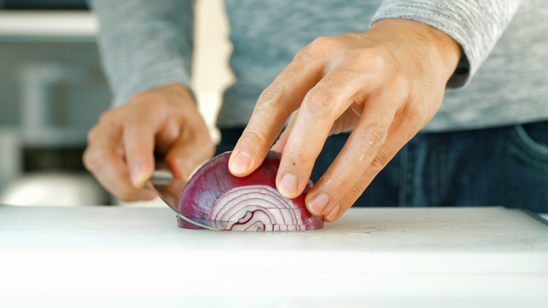 Cutting slits in the side of the onion makes it easier to chop.