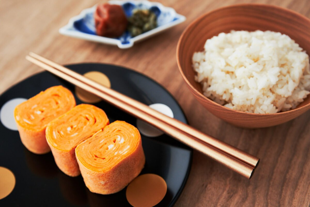 Tamagoyaki is an easy delicious Japanese omelette made by rolling thin layers of seasoned egg into a log. This savory Tamagoyaki recipe is perfect for adding to a bento box lunch.