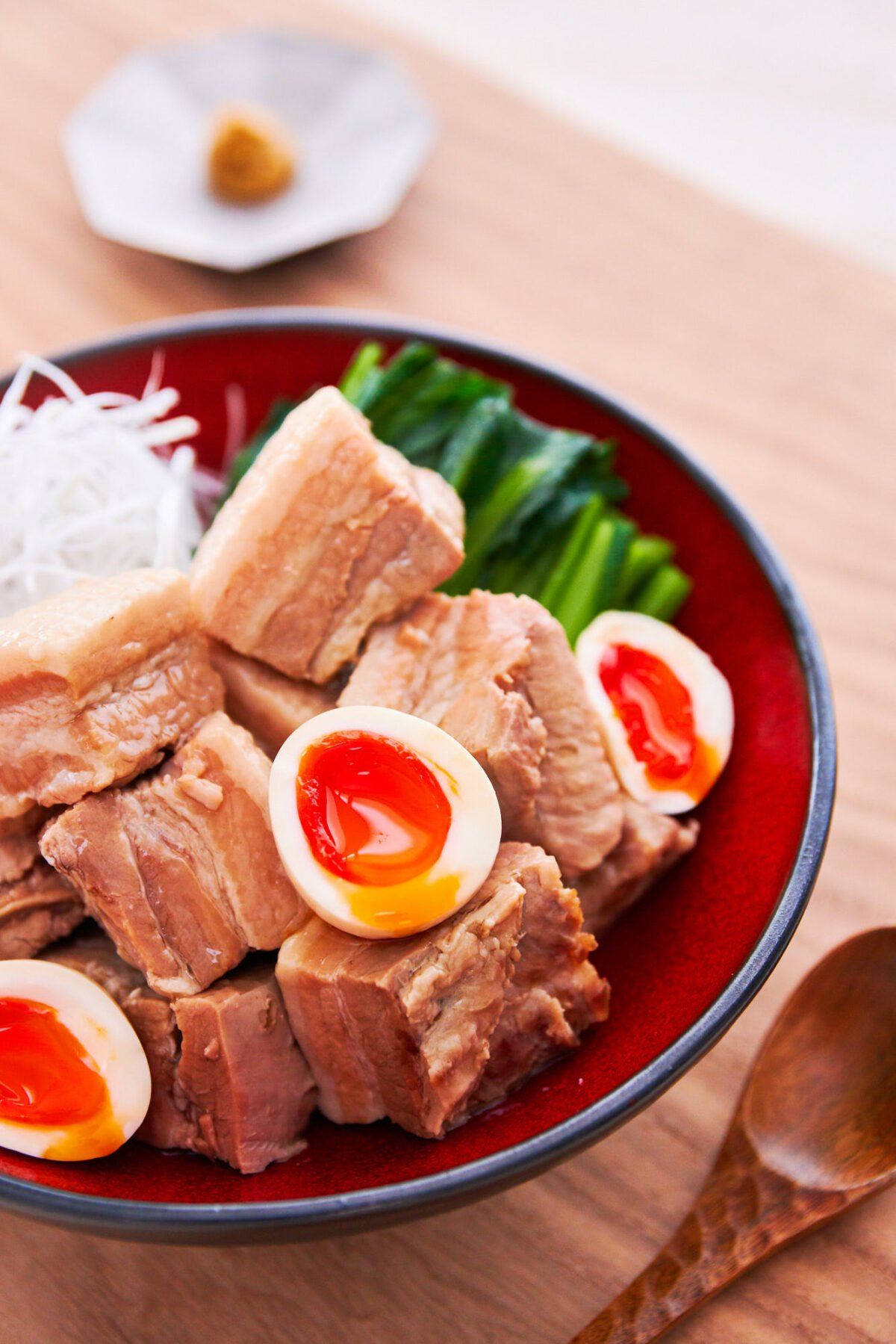 With cubes of pork braised with ginger, garlic and scallions until melt-in-your-mouth tender, this Kakuni recipe is Japanese favorite that makes for a delicious topping for ramen.
