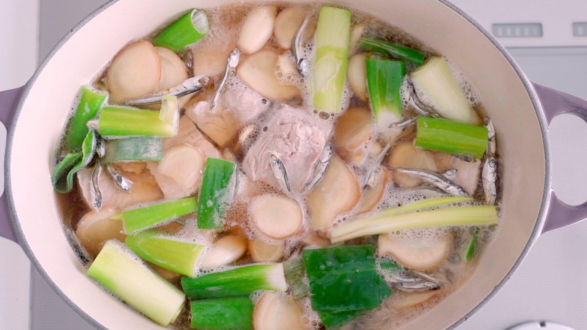 Pork belly, scallions, ginger, and niboshi braising.