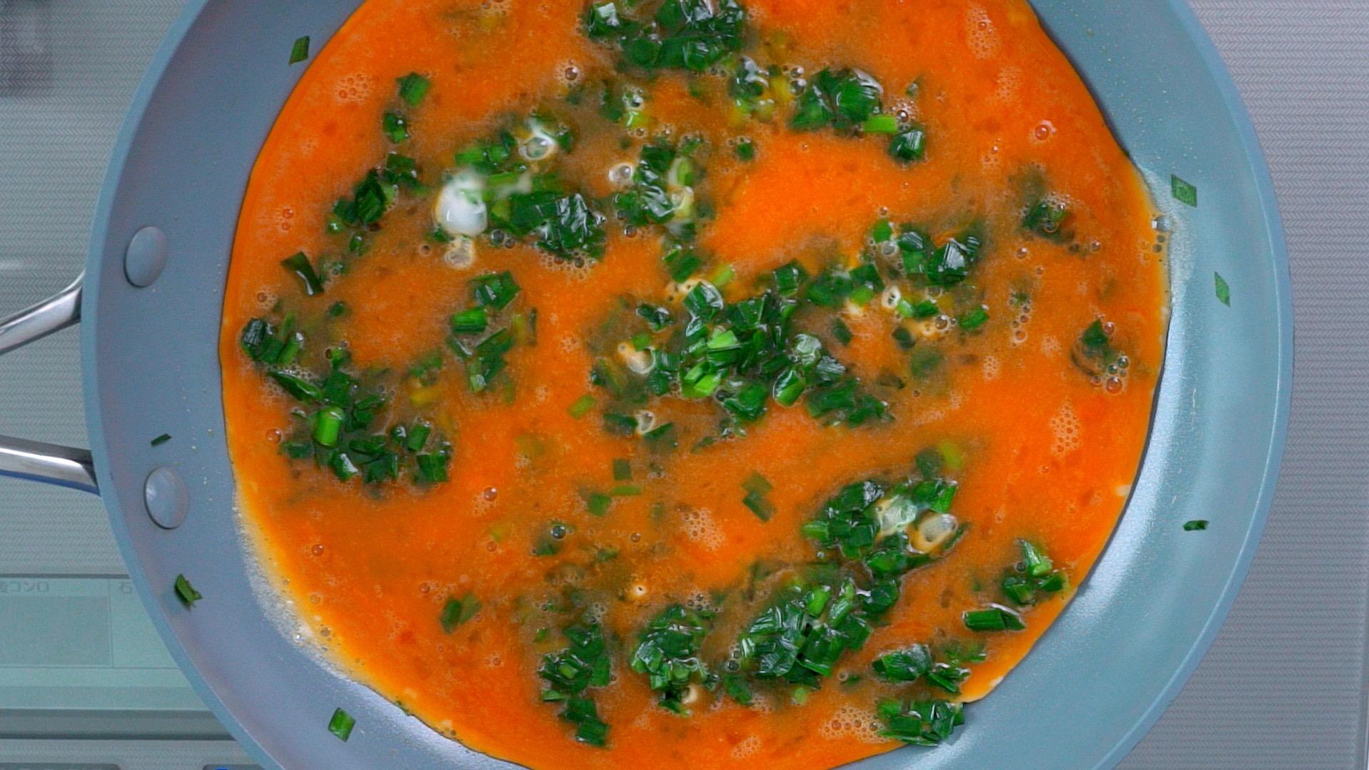 Egg added to the sautéed Nira.
