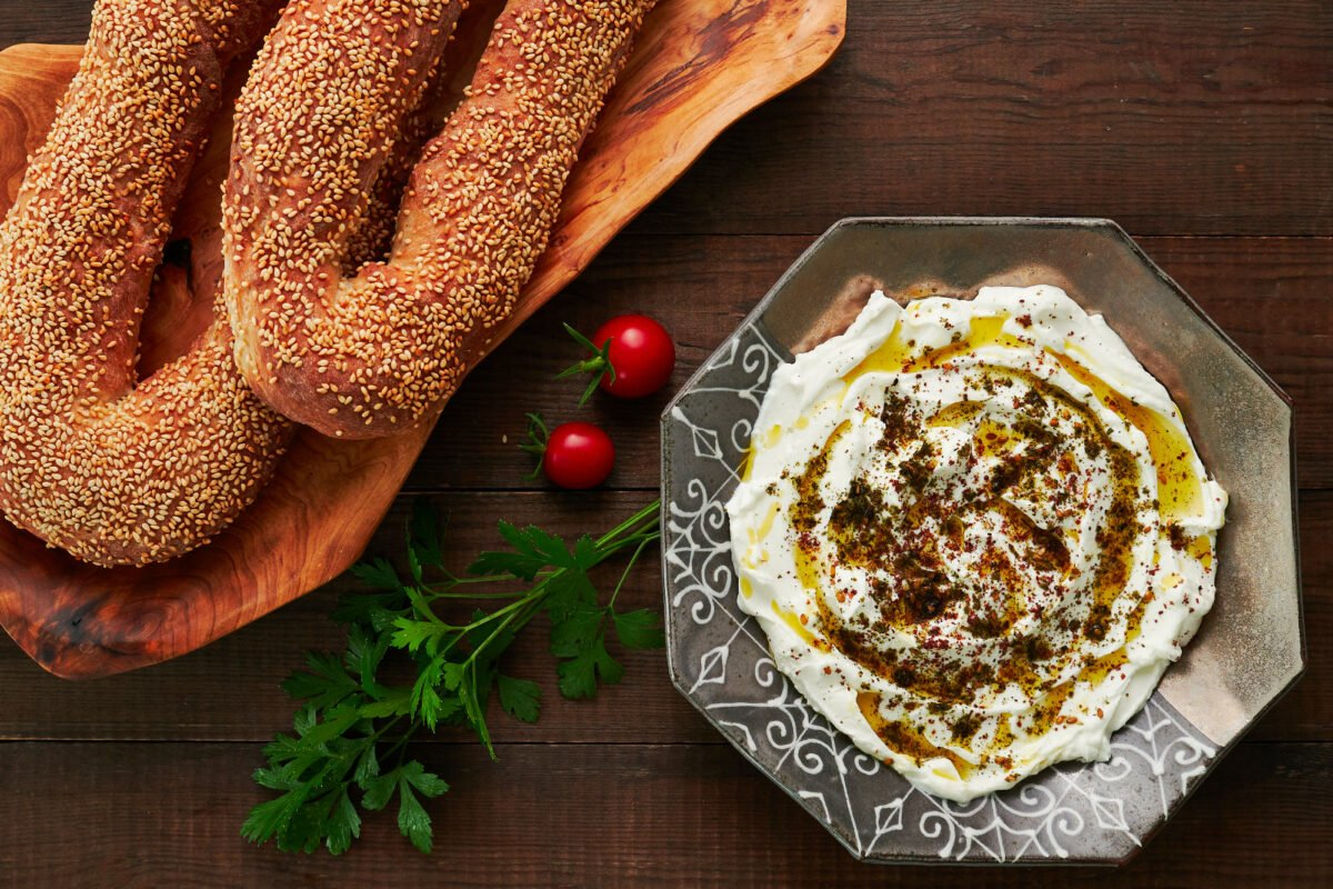 Jerusalem bagels and Labneh garnished with olive oil, sumac and za'atar.