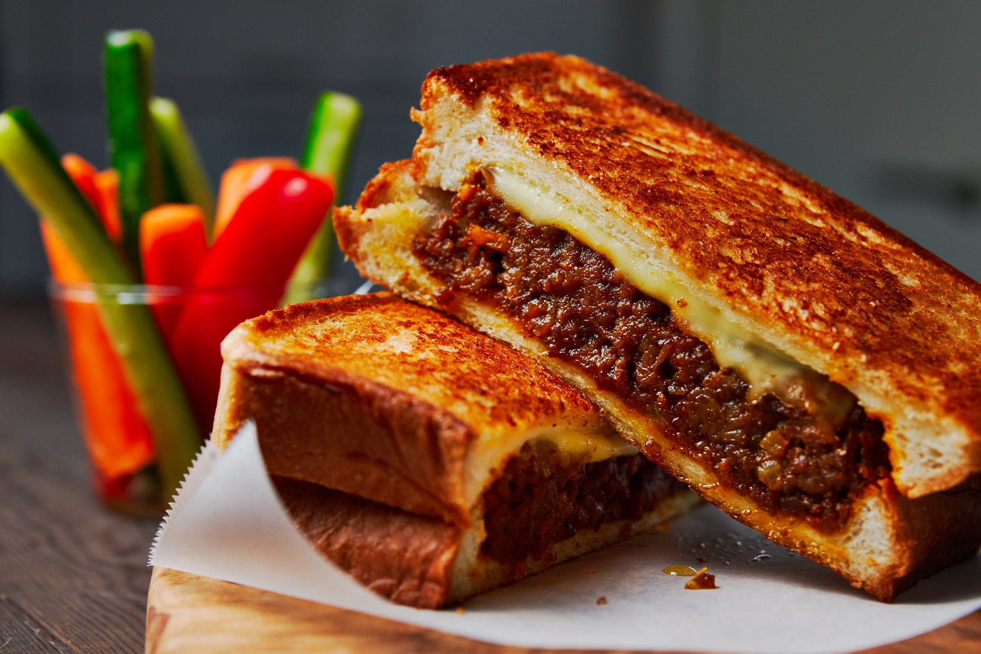 With spicy savoy curry and molten cheese stuffed between two buttery slices of crisp sandwich bread, this mashup of Japanese Curry Bread and a Grilled Cheese Sandwich is irresistibly good.